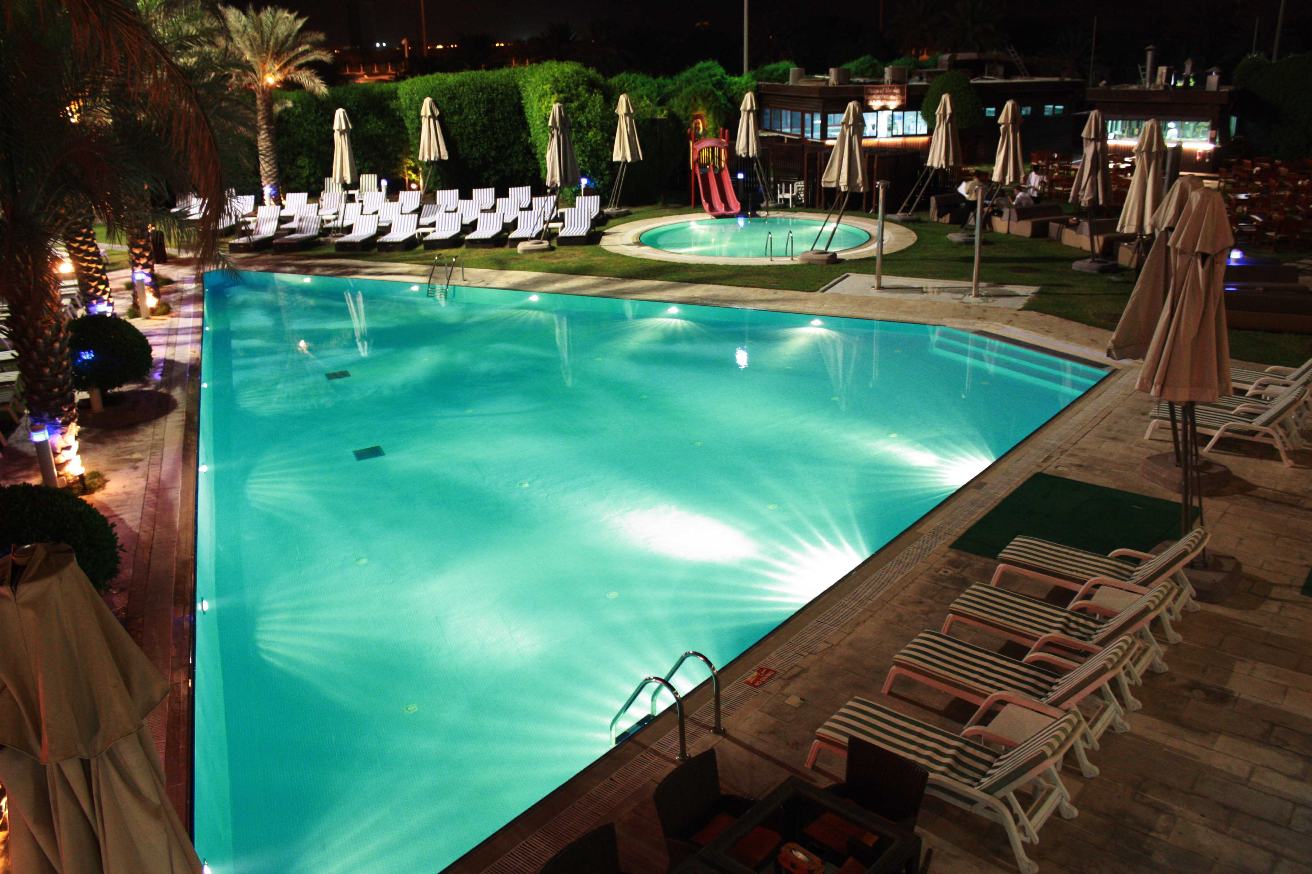 The Village By Night Pool Reception
